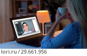 Купить «woman having video call on laptop at home», видеоролик № 29661956, снято 21 февраля 2019 г. (c) Syda Productions / Фотобанк Лори