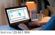 Купить «woman chatting online on laptop at home at night», видеоролик № 29661984, снято 8 апреля 2020 г. (c) Syda Productions / Фотобанк Лори