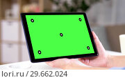 Купить «hands holding tablet pc with green screen at home», видеоролик № 29662024, снято 21 августа 2019 г. (c) Syda Productions / Фотобанк Лори