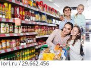 Купить «parents with two kids and purchases in shopping cart», фото № 29662456, снято 25 мая 2019 г. (c) Яков Филимонов / Фотобанк Лори