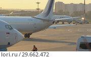 Купить «Official spotting, Utair Aircraft performs taxiing before takeoff», видеоролик № 29662472, снято 1 августа 2018 г. (c) Андрей Радченко / Фотобанк Лори