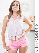 Купить «Smiling girl standing at home», фото № 29662616, снято 24 июня 2017 г. (c) Яков Филимонов / Фотобанк Лори