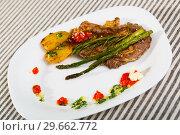 Купить «Veal with grilled vegetables», фото № 29662772, снято 27 июня 2018 г. (c) Яков Филимонов / Фотобанк Лори
