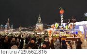 Купить «Moscow, Russia - January 7.2019. Many people on Christmas Fair on the Red Square», видеоролик № 29662816, снято 9 января 2019 г. (c) Володина Ольга / Фотобанк Лори