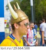 Купить «Russia, Samara, July 2018: a young Swedish fan wearing a helmet with horns at the World Championships.», фото № 29664588, снято 7 июля 2018 г. (c) Акиньшин Владимир / Фотобанк Лори
