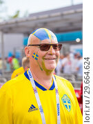 Купить «Russia, Samara, July 2018: football fan from Sweden with a painted face in national colors before the match England Sweden at the World Cup.», фото № 29664624, снято 7 июля 2018 г. (c) Акиньшин Владимир / Фотобанк Лори