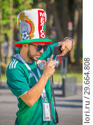 Купить «Russia, Samara, July 2018: Fans of the Mexican national football team are sick during the FIFA 2018 World Cup.», фото № 29664808, снято 2 июля 2018 г. (c) Акиньшин Владимир / Фотобанк Лори