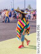 Купить «Russia, Samara, July 2018: beautiful Mexican fans in national clothes before the match Brazil Mexico for the World Cup.», фото № 29664956, снято 2 июля 2018 г. (c) Акиньшин Владимир / Фотобанк Лори