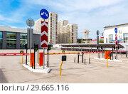 Купить «Automatic rising arm barrier for entry or stop traffic», фото № 29665116, снято 6 мая 2017 г. (c) FotograFF / Фотобанк Лори