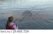 Купить «A woman fishing on rocks», видеоролик № 29665724, снято 25 июня 2019 г. (c) Wavebreak Media / Фотобанк Лори