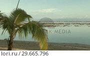 Купить «Stock Footage Tropical Island», видеоролик № 29665796, снято 18 сентября 2019 г. (c) Wavebreak Media / Фотобанк Лори