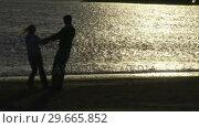 Купить «Couple on Beach», видеоролик № 29665852, снято 24 января 2019 г. (c) Wavebreak Media / Фотобанк Лори