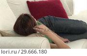 Купить «Woman Relaxing Listening to Music», видеоролик № 29666180, снято 15 февраля 2008 г. (c) Wavebreak Media / Фотобанк Лори