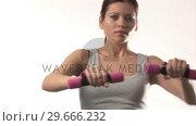 Купить «Woman working out», видеоролик № 29666232, снято 15 февраля 2008 г. (c) Wavebreak Media / Фотобанк Лори