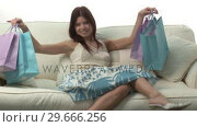 Купить «Woman With Shopping Bags», видеоролик № 29666256, снято 15 февраля 2008 г. (c) Wavebreak Media / Фотобанк Лори