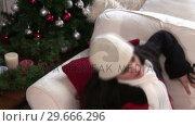 Купить «Woman with Christmas Presents», видеоролик № 29666296, снято 26 февраля 2008 г. (c) Wavebreak Media / Фотобанк Лори