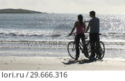 Купить «A couple Riding Bycles», видеоролик № 29666316, снято 26 февраля 2008 г. (c) Wavebreak Media / Фотобанк Лори