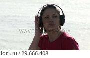 Купить «Woman Listening to Music», видеоролик № 29666408, снято 26 февраля 2008 г. (c) Wavebreak Media / Фотобанк Лори