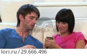 Купить «Young Couple on Sofa With Laptop», видеоролик № 29666496, снято 1 марта 2008 г. (c) Wavebreak Media / Фотобанк Лори
