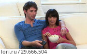 Купить «Young Couple Watching Television», видеоролик № 29666504, снято 1 марта 2008 г. (c) Wavebreak Media / Фотобанк Лори
