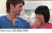 Купить «Young Couple Watching Television», видеоролик № 29666508, снято 1 марта 2008 г. (c) Wavebreak Media / Фотобанк Лори