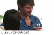 Купить «A Couple Enjoying a Glass of Wine», видеоролик № 29666520, снято 1 марта 2008 г. (c) Wavebreak Media / Фотобанк Лори