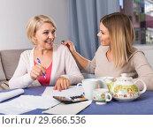 Купить «Daughter helps mother to lead home accounting», фото № 29666536, снято 13 ноября 2017 г. (c) Яков Филимонов / Фотобанк Лори