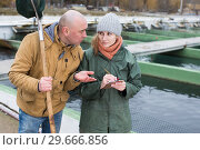 Купить «Owner of sturgeon farm giving instruction to female», фото № 29666856, снято 4 февраля 2018 г. (c) Яков Филимонов / Фотобанк Лори