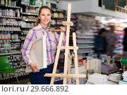 Купить «Woman shopping various supplies in art store», фото № 29666892, снято 12 апреля 2017 г. (c) Яков Филимонов / Фотобанк Лори
