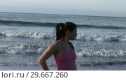 Купить «Woman Stretching on Beach», видеоролик № 29667260, снято 24 января 2019 г. (c) Wavebreak Media / Фотобанк Лори