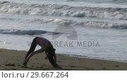 Купить «Woman Stretching on Beach», видеоролик № 29667264, снято 24 января 2019 г. (c) Wavebreak Media / Фотобанк Лори