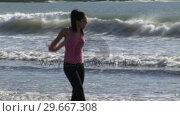Купить «Woman on Beach Running», видеоролик № 29667308, снято 22 августа 2019 г. (c) Wavebreak Media / Фотобанк Лори