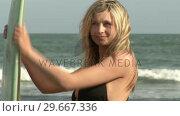 Купить «Woman with Surfboard», видеоролик № 29667336, снято 24 января 2019 г. (c) Wavebreak Media / Фотобанк Лори