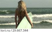 Купить «Woman with Surfboard», видеоролик № 29667344, снято 24 января 2019 г. (c) Wavebreak Media / Фотобанк Лори