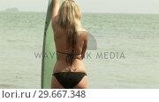 Купить «Woman with Surfboard», видеоролик № 29667348, снято 23 января 2019 г. (c) Wavebreak Media / Фотобанк Лори