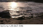 Купить «Waves hitting the shore», видеоролик № 29667596, снято 19 сентября 2019 г. (c) Wavebreak Media / Фотобанк Лори