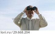 Купить «Businessman watching via binoculas», видеоролик № 29668204, снято 30 марта 2009 г. (c) Wavebreak Media / Фотобанк Лори