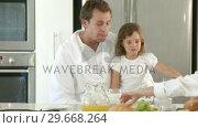 Купить «Patient Father and cranky daughter have breakfast», видеоролик № 29668264, снято 2 апреля 2009 г. (c) Wavebreak Media / Фотобанк Лори