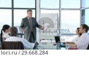 Купить «CEO in a business meeting explaining with a Whiteboard», видеоролик № 29668284, снято 29 марта 2009 г. (c) Wavebreak Media / Фотобанк Лори