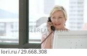 Купить «Professionally experienced businesswoman on her phone», видеоролик № 29668308, снято 30 марта 2009 г. (c) Wavebreak Media / Фотобанк Лори