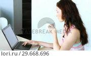 Купить «Woman using a laptop and drinking coffee. Communication society», видеоролик № 29668696, снято 27 июня 2019 г. (c) Wavebreak Media / Фотобанк Лори