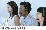 Купить «AfroAmerican man working in a call center», видеоролик № 29670564, снято 1 октября 2009 г. (c) Wavebreak Media / Фотобанк Лори