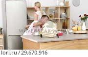 Купить «Parents and daughter in the kitchen after school», видеоролик № 29670916, снято 13 октября 2009 г. (c) Wavebreak Media / Фотобанк Лори