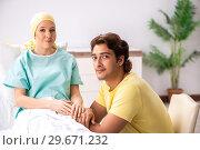 Купить «Husband looking after wife in hospital», фото № 29671232, снято 3 октября 2018 г. (c) Elnur / Фотобанк Лори