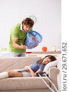 Купить «Husband helping leg injured wife in housework», фото № 29671652, снято 4 октября 2018 г. (c) Elnur / Фотобанк Лори