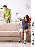 Купить «Husband helping leg injured wife in housework», фото № 29671660, снято 4 октября 2018 г. (c) Elnur / Фотобанк Лори