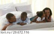 Купить «Happy AfroAmerican family under the sheets», видеоролик № 29672116, снято 21 октября 2009 г. (c) Wavebreak Media / Фотобанк Лори