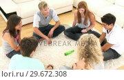 Купить «Teens relaxing at home », видеоролик № 29672308, снято 22 октября 2009 г. (c) Wavebreak Media / Фотобанк Лори