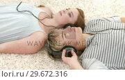 Купить «Teenage Couple listening to music », видеоролик № 29672316, снято 22 октября 2009 г. (c) Wavebreak Media / Фотобанк Лори
