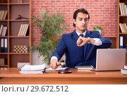Купить «Young handsome lawyer working in his office», фото № 29672512, снято 10 сентября 2018 г. (c) Elnur / Фотобанк Лори